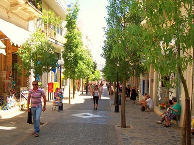 Tree-lined pedestrianised street Agious Nikolaos